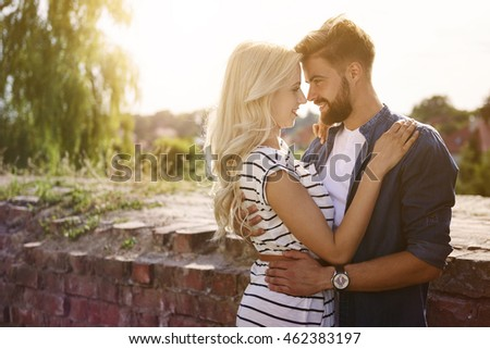 Man and woman embracing in the sunshine