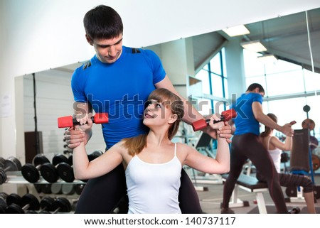 man and  woman goes in for sports in sport hall
