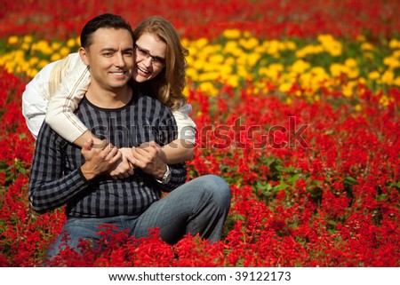 man and woman in brackets laughing in the flowers