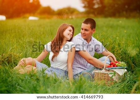 men and women fuck on picnic blanket