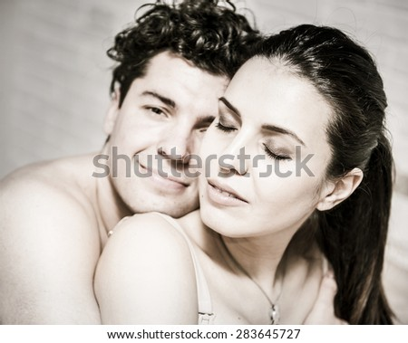 man and woman tenderly hugging.
