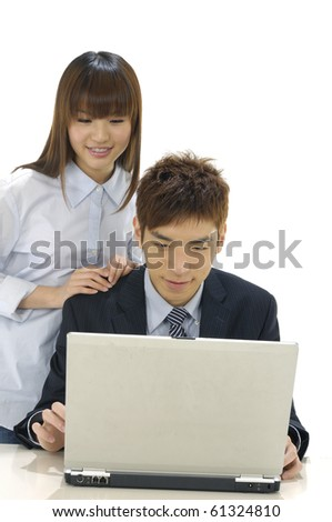 Man and woman with computer on white background