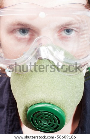 Man closeup in a respirator and safety glasses