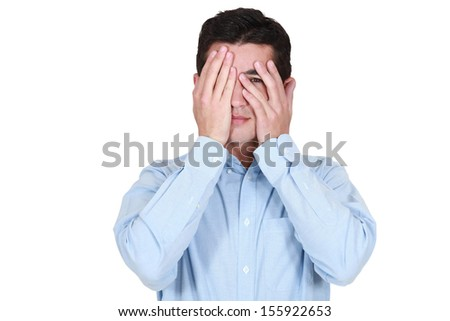 Man covering his eyes with his hands