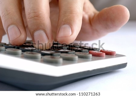 man does the calculation on a calculator