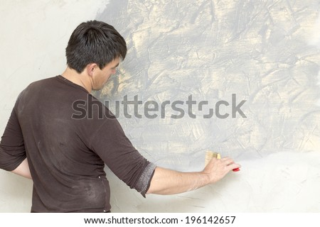 man doing finishing repairs