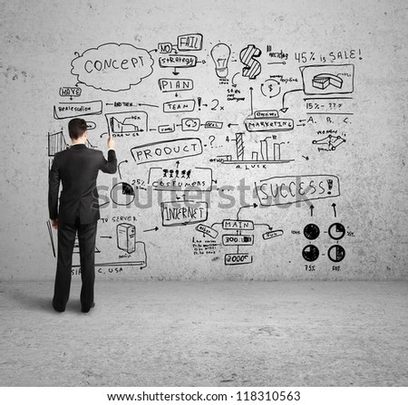 man drawing strategy on white wall stock photo 132892574