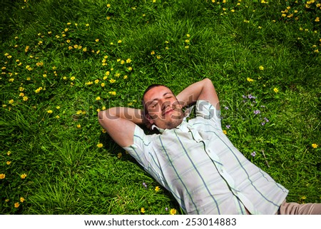 Man dreaming lying on the grass
