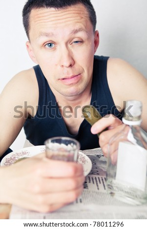 Man drinks vodka and cucumber bites