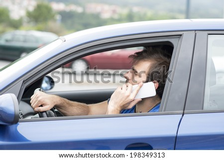 Man driving and talking by smart phone, dangerous concept.