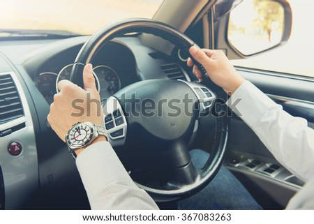 man driving car, steering wheel of a car, focus at finger. Hand fastening a seat belt, wearing safety belt driving ,vintage style color tone