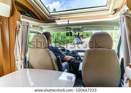 Man driving on a road in the Camper Van. Caravan car Vacation. Family vacation travel, holiday trip in motorhome