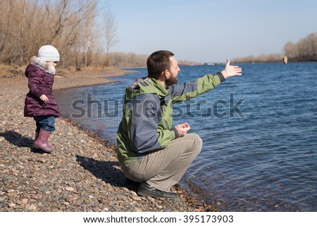 Man dropping a stone into the river