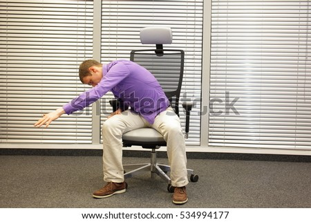 man exercising on chair in office, healthy lifestyle