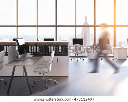 Man going to his workplace in New York City legal company. Computers on desks. Panoramic view. Concept of successful businessman
