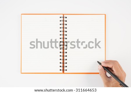 Man hand holding pen and writing notebook  on white background for text and background.copy space