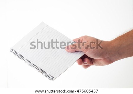 Man hand holds empty note pad