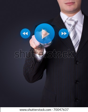 Man hand pressing media player button