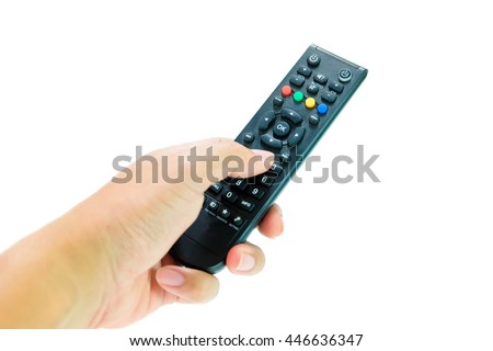 man hand pushing button remote control tv to change channel