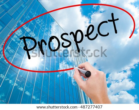 Man Hand writing Prospect with black marker on visual screen. Business, technology, internet concept. Modern business skyscrapers background. Stock Image