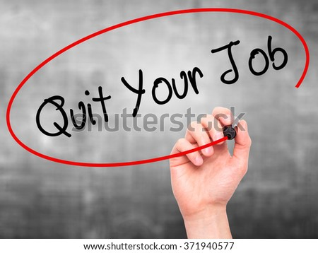 Man Hand writing Quit Your Job with black marker on visual screen. Isolated on background. Business, technology, internet concept. Stock Photo