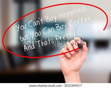 Man Hand writing You Cant Buy Happiness but You Can Buy Coffee And Thats Pretty Close with black marker on visual screen. Isolated on office. Business, technology, internet concept.