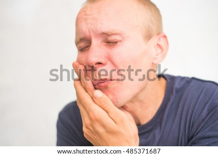 man has a toothache
