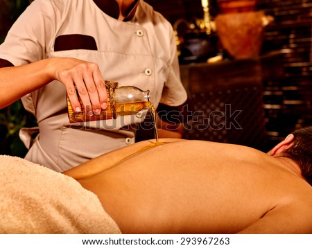 man having oil ayurveda spa treatment stock photo 293967263 shutterstock. Black Bedroom Furniture Sets. Home Design Ideas