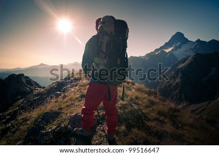 man hiking in a mountains