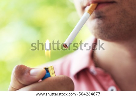 Man holding and lighting up cigarette