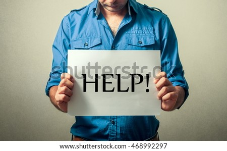 bottle paper message stock photo shutterstock man holding paper the help text