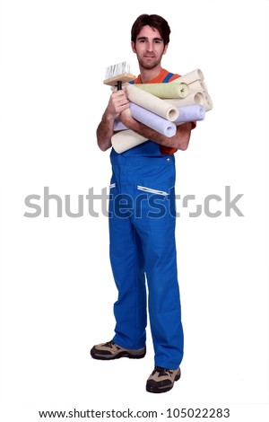 Man holding selection of wallpaper rolls