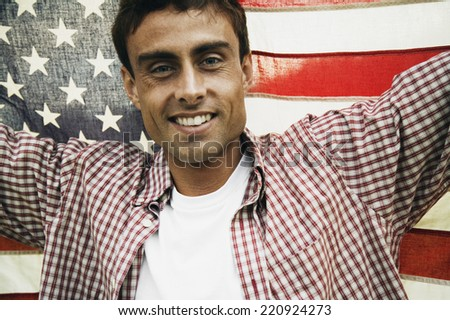 Man holding up American flag