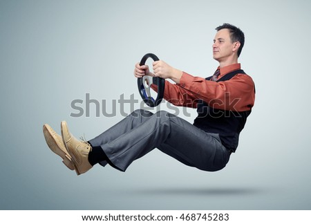 Man in a shirt and tie car driver with a steering wheel