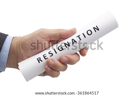 Man in a suit gives a rolled letter of resignation isolated on white background. Image with clipping path.