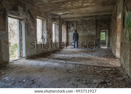 man in an old house