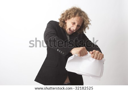 Man in anger breaking a paper