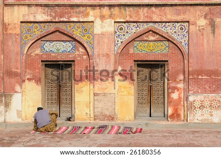 Man in front of mosque, Lahore, Pakistan