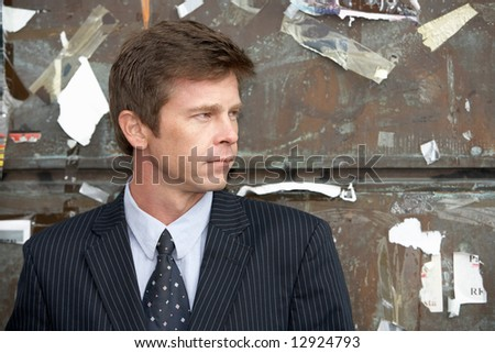Man in front of wall used for advertising