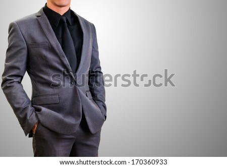 man in gray suit with right copy space