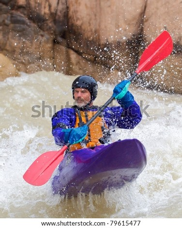 Man In Purple Kayak Launched Off a Wave - Grand Canyon National Park