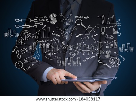 Man in suit holding tablet pc. Around fly business sketches
