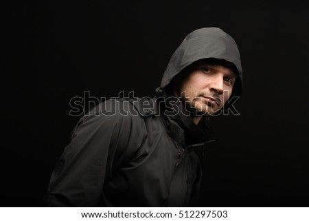 man in the jacket on a dark background.