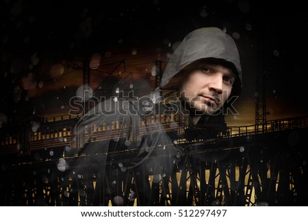 man in the jacket on a dark background. double exposure with a train.