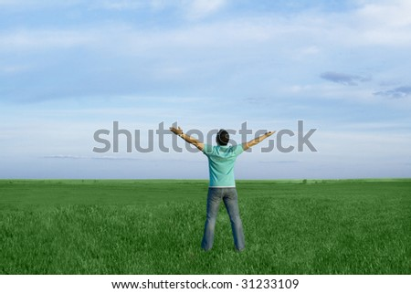 man in the meadow with dark blue sky