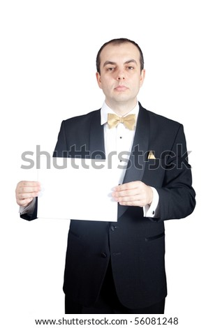 Man in tuxedo holding blank piece of paper