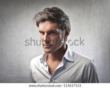 Man in white shirt looking seriously at someone