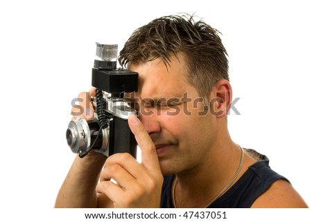 man is taking pictures with old fashioned photo camera over white background