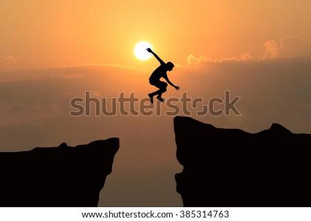 Man jump through gap between hill stock photo 385314769 for Jump the gap
