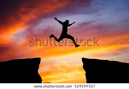 Man jumping across gap one rock stock photo 524599567 for Jump the gap